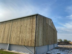 Agricultural building with concrete panels